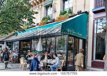 PARIS, FRANCE, APRIL 25 2016. Les Deux Magots, famous café in the Saint-Germain-des-Prés  area