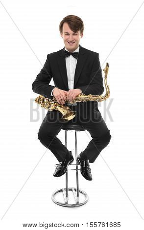 Attractive saxophonist with a saxophone in a suit on a white background.