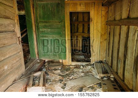 The Wooden Inner Porch Of Ruined Abandoned Private Country House In Exclusion Area After Chernobyl Disaster. The Consequences Of The Nuclear Contamination.