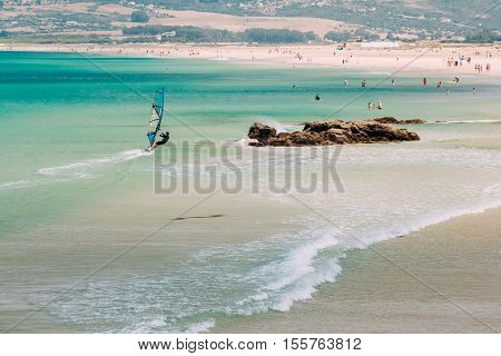 People resting at beach in Tarifa, Spain. Tarifa is most popular places in Spain for vacation