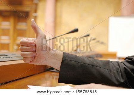 Thumb up as a symbol of a success