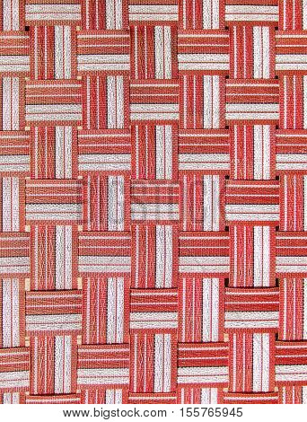 Redwhite and black plastic woven crisscross texture.
