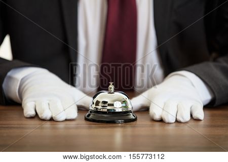 Butler Service Bell On A Wooden Desk