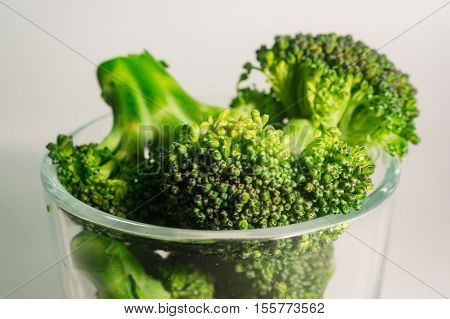 Green Brocolli In Transparant Glass On White Background