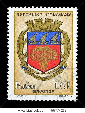 MADAGASCAR-CIRCA 1964 : Cancelled postage stamp printed by Madagascar, that shows Arms of Majunga.