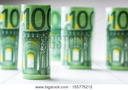 Several hundred euro banknotes stacked by value.Rolls Euro banknotes.Euro currency money. Banknotes stacked on each other in different positions