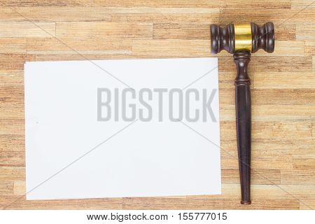 Wooden Law Gavel, empty note paper on wooden table