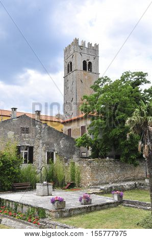 Medieval istrian town of Motovun Croatia shot from the castles garden showing the tower a well and ancient houses.