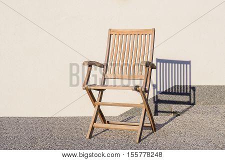 Teak Foldable Deck Chair On Terrace