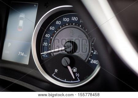 Sport car speedometer and fuel indicator. Close up view