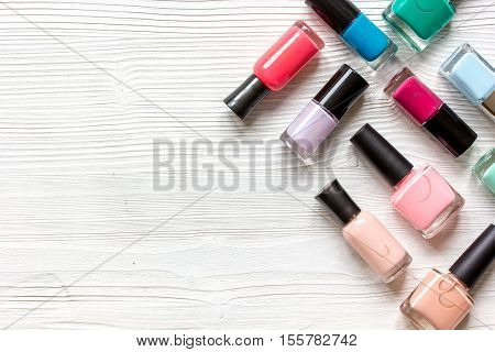 group of nail polish on wooden background top view.