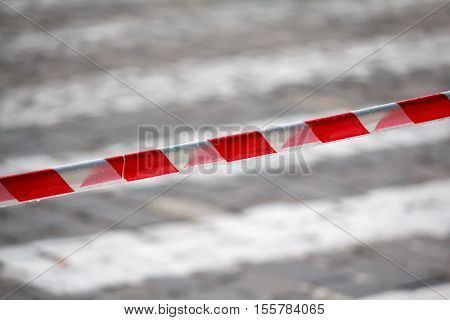 Fencing red and white ribbon which prohibits movement. Danger