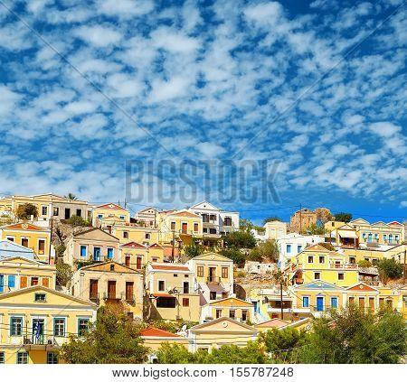 Greece. Dodecanesse. Island Symi Simi . Colorful houses on rocks
