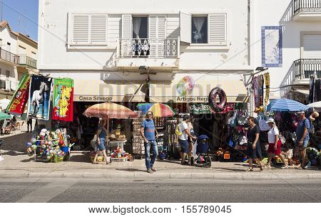 NAZARE, PORTUGAL - September 12, 2016: View of the retail shops along the popular beachfront avenue in the fishing village of Nazare Portugal
