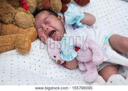 Cute asian  little newborn unsleep and crying