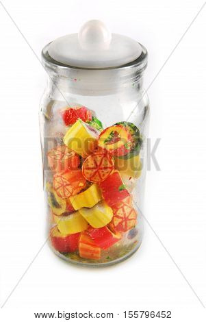 jar with rainbow candies isolated on white