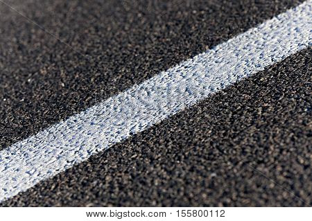 photographed close-up of the new road for the movement of vehicles, road markings - white stripes