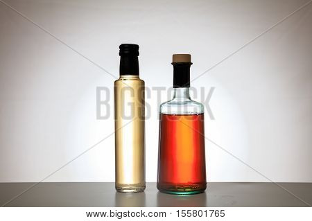 Bottles Of Vinegar On Gradient Background