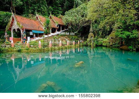 CHIANGMAI THAILAND - September 2016 : Main entrance at Chiangdao Cave surrounded by green fish pond at Doi Chung mountain on Chiangmai. One of popular tourist attractions in Thailand