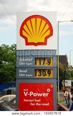 ASHFORD, ENGLAND - JUNE 17, 2008: Signage outside of a Shell petrol filling station. One of the largest companies in the world the Anglo Dutch multinational was formed in 1907.