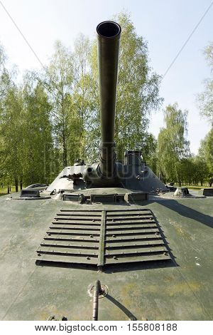 photographed close-up of the gun barrel, situated on an old military equipment. tank for fighting