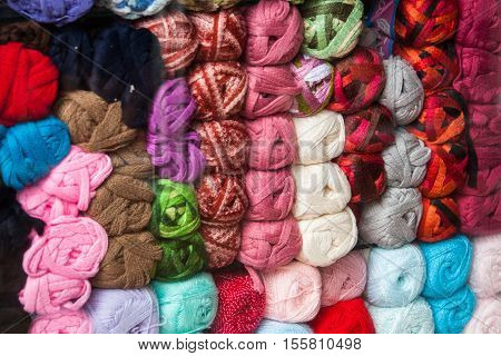 Ecuador is filled with hand made textiles made from balls of colorful wool like these ones stacked up in a wool shop