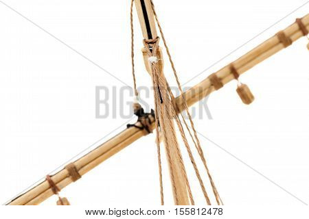 photographed close-up of a model sailing ship, made by hand from the tree, a small depth of field , on a light background