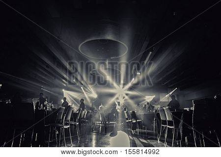 restaurant black and white photo.ballroom black and white photo.wedding partypeople dance in wedding party black photo