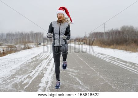 Athletic Woman Jumping High In The Hat Of Santa.