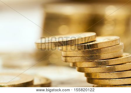 photographed close-up Polish coins. Zloty stacked together, shallow depth of field