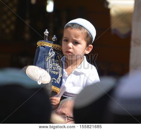 JERUSALEM ISRAEL 26 10 16: Jewish child celebrate Simchat Torah. Simchat Torah is a celebratory Jewish holiday marks the completion of the annual Torah reading cycle.