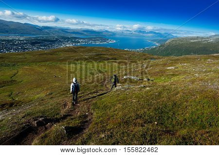 Couple descending from Norway mountain background hd