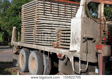 Stack of prestressed concrete slabs loaded on truck for construction Side view