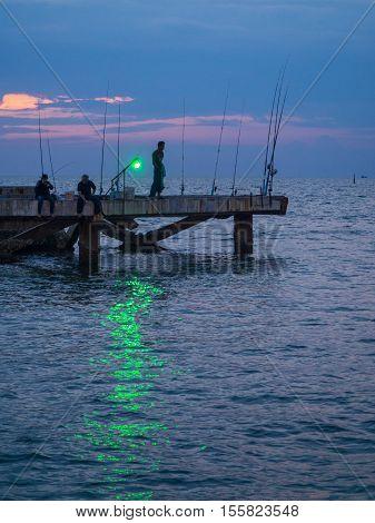 Fisherman Fishing Squids.