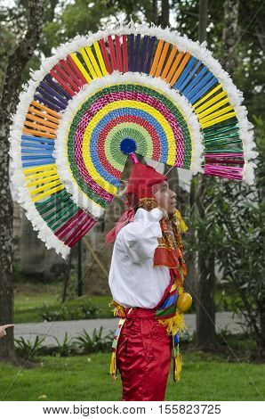 PUEBLA, PUEBLA - OCTOBER 2, 2016: Dancer performing the Quetzal Dance in Puebla, Puebla, Mexico. The Quetzal Dance is one of the most colorful folkloric dances anywhere in the country.