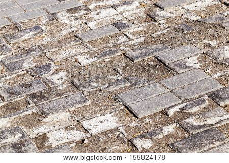 photographed close-up part of the road made of cobblestones, which was eventually spoiled