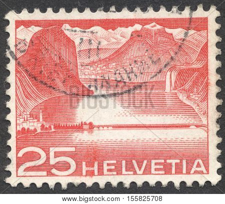 MOSCOW RUSSIA - CIRCA OCTOBER 2016: a post stamp printed in SWITZERLAND shows Lake dam near Melide (Lake Lugano) the series