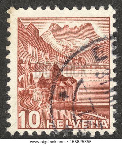 MOSCOW RUSSIA - CIRCA OCTOBER 2016: a post stamp printed in SWITZERLAND shows Chillon castle at Lake of Geneva & Dents du Midi the series