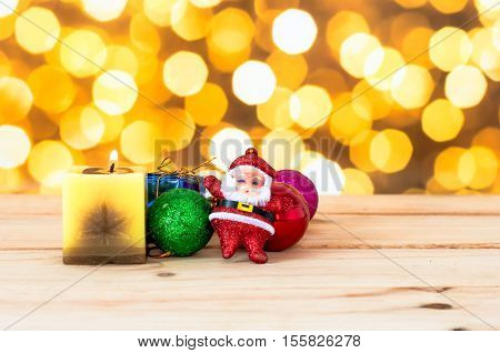 The Christmas Ball With Yellow Candle On Wooden In Bokeh Light Background, Accessories Of Chirstmas