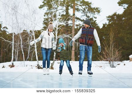 Cheerful family skating in park