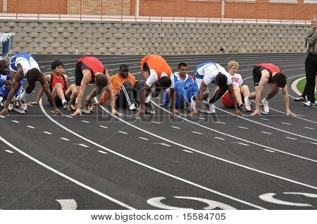 Teen Boys In The Starting Blocks At A High School Sprint Race