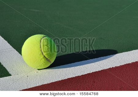 Yellow Tennis Ball Near Baseline of Tennis Court poster