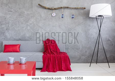 Ascetic Living Room With Sofa And Two Cups On Table
