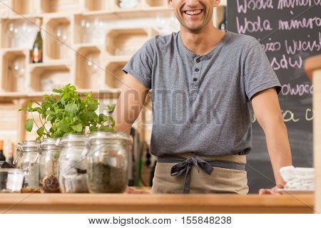Happy Barista In A Cozy Restaurant