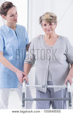 Woman Walking With The Walking Frame