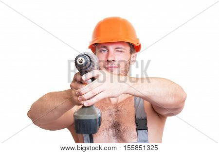 A man in overalls and helmet with a screwdriver isolated on white background.