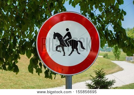 A Warning Sign Telling That Horseback Riding Is Prohibited Beyond This Point.