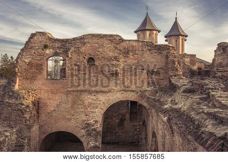 Ruins Of Old Castle In Targoviste, Romania. Old Royal Court Ruins And The Royal Church Of Targoviste