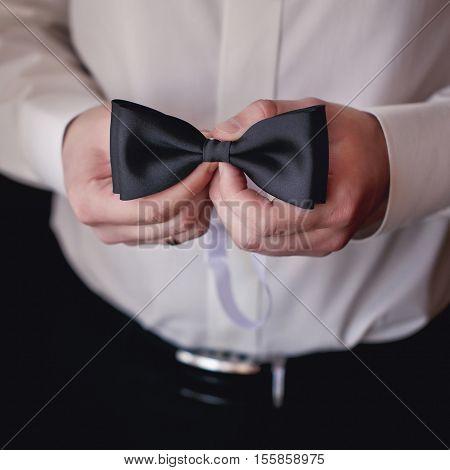 Hands of wedding groom getting ready in suit.