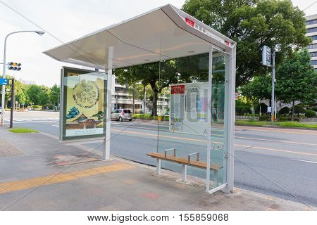 Japanese Bus Stop, Japanese Bus Stop At Front Of Nagoya City Hall Building And The Clock Tower.